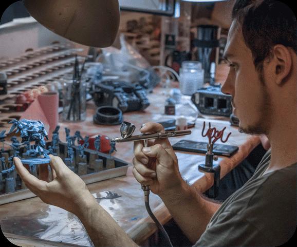 Top Miniatures man painting